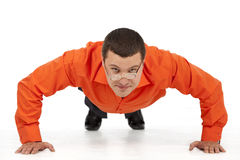 Funny businessman doing push-ups Royalty Free Stock Images