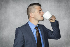 Funny businessman drinking coffee Stock Photos