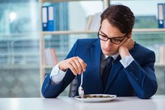The funny businessman eating gold coins in office. Funny businessman eating gold coins in office stock photos