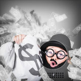 Funny businessman with falling money. Success Stock Photo