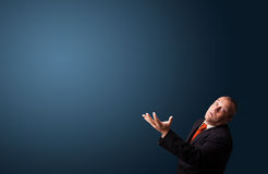 Funny businessman gesturing with copy space Royalty Free Stock Photo