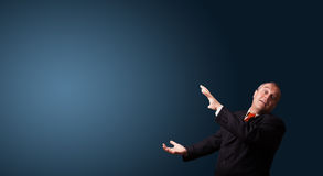 Funny businessman gesturing with copy space Stock Images