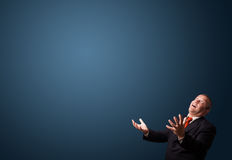 Funny businessman gesturing with copy space Stock Photo
