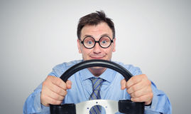 Funny businessman in glasses with a steering wheel Stock Photography