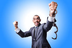 Funny businessman with handcuffs Stock Photo