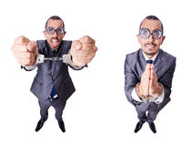 The funny businessman with handcuffs on white Stock Images