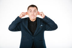 Funny businessman holding his ears Royalty Free Stock Photo