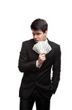 Funny businessman holding money Stock Image