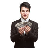 Funny businessman holding money Royalty Free Stock Images