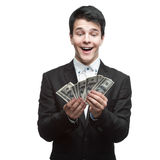 Funny businessman holding money Royalty Free Stock Photos