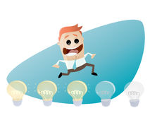 Funny businessman jumping over light bulbs Stock Photography