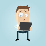 Funny businessman is looking surprised in his tablet Royalty Free Stock Image
