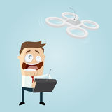Funny businessman is playing with a drone Royalty Free Stock Images