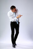 Funny businessman pointing at something Royalty Free Stock Photography