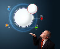 Funny businessman presenting abstract modern pie chart with copy Royalty Free Stock Image