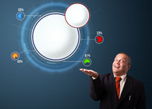 Funny businessman presenting abstract modern pie chart with copy Royalty Free Stock Photos