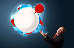 Funny businessman presenting abstract modern speech bubble copy Royalty Free Stock Photo