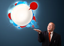 Funny businessman presenting abstract modern speech bubble copy Stock Images
