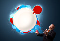 Funny businessman presenting abstract modern speech bubble copy Royalty Free Stock Image