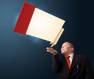 Funny businessman presenting modern origami copy space Royalty Free Stock Photo