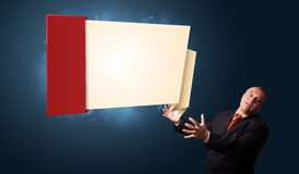 Funny businessman presenting modern origami copy space Stock Photography