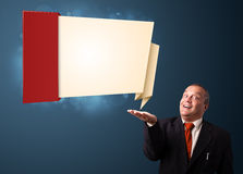 Funny businessman presenting modern origami copy space Stock Photos