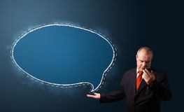 Funny businessman presenting speech bubble c Stock Images