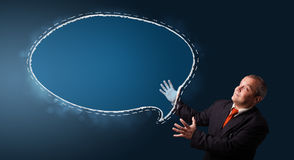 Funny businessman presenting speech bubble copy space Royalty Free Stock Photo