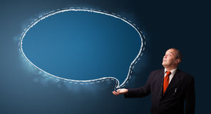 Funny businessman presenting speech bubble copy space Stock Image