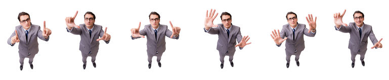 The funny businessman pressing virtual buttons isolated on white Stock Images