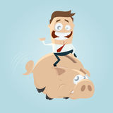 Funny businessman riding a piggy bank Royalty Free Stock Photo