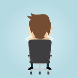 Funny businessman sitting in an office chair Stock Image