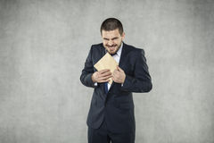 Funny businessman take a bribe Royalty Free Stock Photos