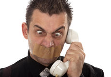 Funny businessman with tape on his mouth Royalty Free Stock Photo