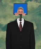 Funny Businessman, Technology, Computer, Suit. A funny businessman is in a technology computer and a business suit and tie. Surreal surrealism can be used for Royalty Free Stock Image