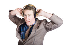 Funny businessman wearing earphones on white Stock Images