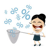 Funny businesswoman catching percent signs Stock Photo