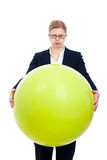Funny businesswoman with exercise ball Stock Image