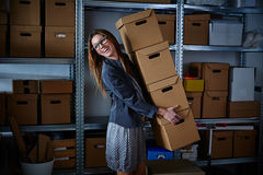Funny businesswoman holding storage boxes Royalty Free Stock Photo
