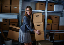 Funny businesswoman holding storage boxes Royalty Free Stock Images