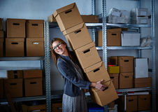 Funny businesswoman holding storage boxes Stock Images