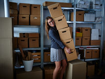 Funny businesswoman holding storage boxes Royalty Free Stock Photos