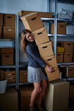 Funny businesswoman holding storage boxes Stock Image