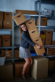 Funny businesswoman holding storage boxes Stock Photo