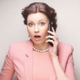 Funny businesswoman with mobile phone Stock Image