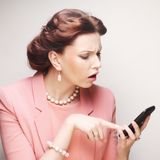 Funny businesswoman with mobile phone Stock Photos