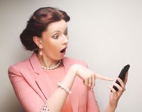 Funny businesswoman with mobile phone Stock Photo