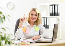Funny businesswoman overwhelmed with sticky Royalty Free Stock Photography