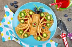 Funny Butterfly face pancakes with berries and fruits for kids`. Snack food. Creative breakfast idea for kids royalty free stock images