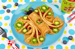 Funny Butterfly face pancakes with berries and fruits for kids`. Snack food. Creative breakfast idea for kids stock photos